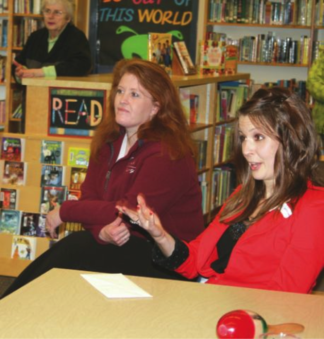 Cheri Patterson, left, superintendent and prinicpal of Cosmopolis School, and Cassie Lentz, right, program officer for Grays Harbor Community Foundation, discuss with the school staff the award of $30,000 to the district, part of the Foundation's Technology in the Classroom initiative.